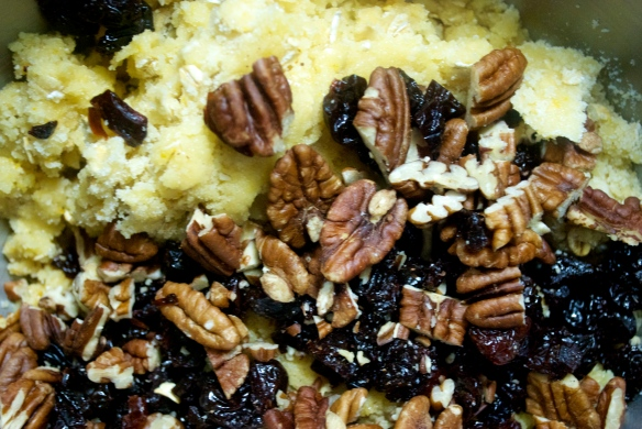 Mixing in the fruit and nuts