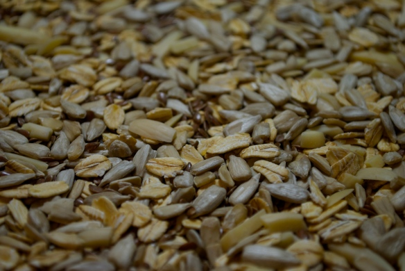 Oats, sunflower seeds and flax toasting