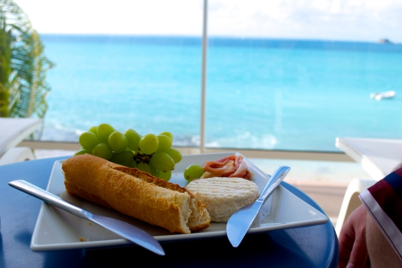 A snack of French cheese, fruit and jamon, sitting on our balcony. Grand Case, St. Martin.