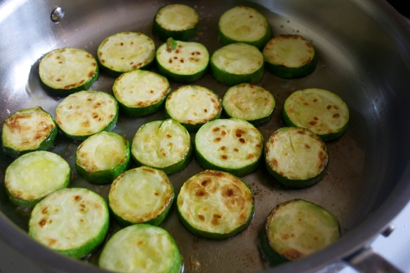 Searing zucchini slices for the succotash