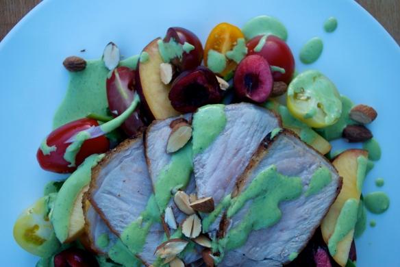 Salad with roasted pork, cherries, spinach yogurt sauce