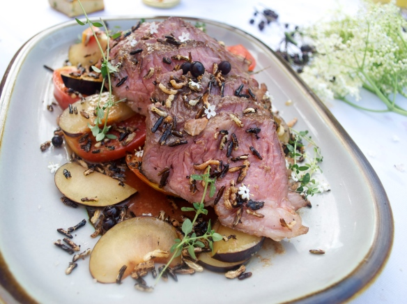 Striploin, fresh tomatoes, plums and elderberries and garnished with puffed wild rice and a plum-beef reduction.