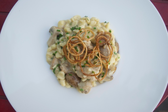 Rabbit and spaetzle in a creme fraiche-mustard sauce topped with crispy shallots.