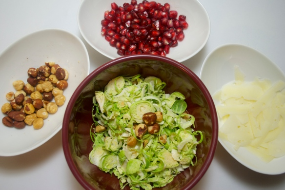 Prepping: shaved Brussels sprouts, hazelnuts, pomegranate seeds and Parmesan