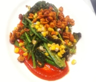 Grilled raab with corn, harissa and peanuts
