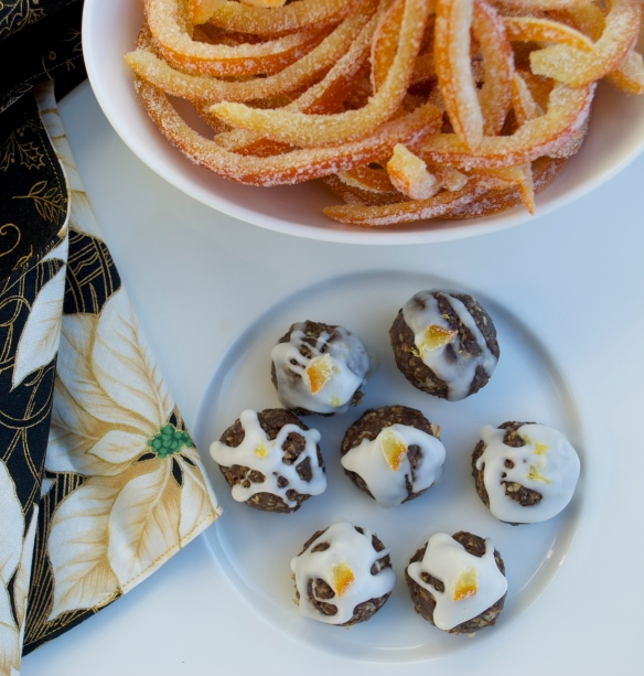 "Gingerbread ""truffles"" with lemon icing and candied orange peels"