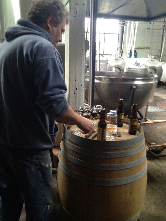 Alan Spints pouring us samples of beer in the brewery.