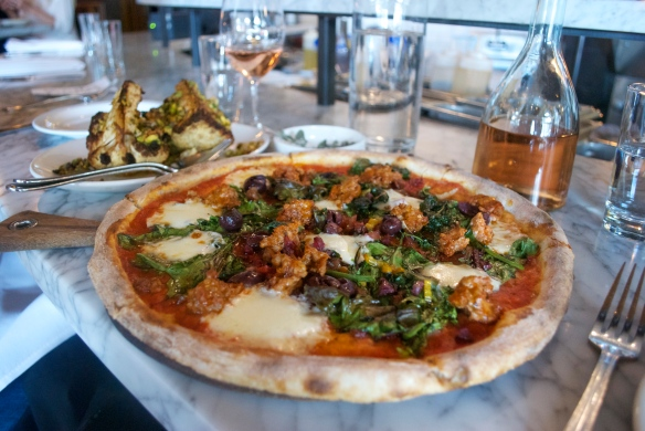 Roasted cauliflower with agro dolce sauce, and an incredible pizza with sausage, olives and mozzarella.