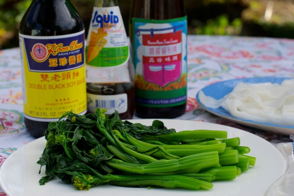 My mise en place -- Black soy sauce, Thai fish sauce, thin soy sauce, blanched Chinese broccoli and rice noodles...