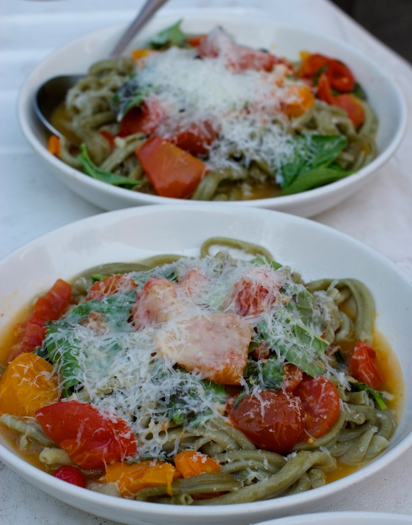 Tomato leaf pasta, fresh tomatoes and Parmesan brodo