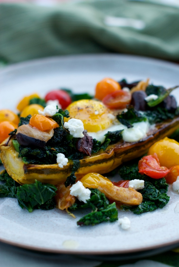 Delicata squash with garlicky kale, goat cheese and a baked egg.