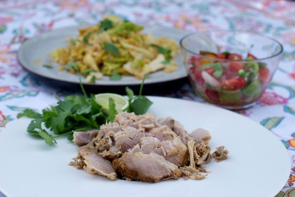 The fixin's: braised pork (not yet fried), cilantro, lime, pico de gallo and cabbage.