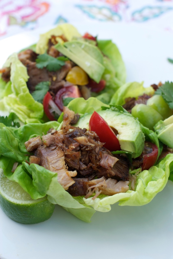 Crispy carnitas wrapped in Bibb lettuce with avocado and cherry tomatoes