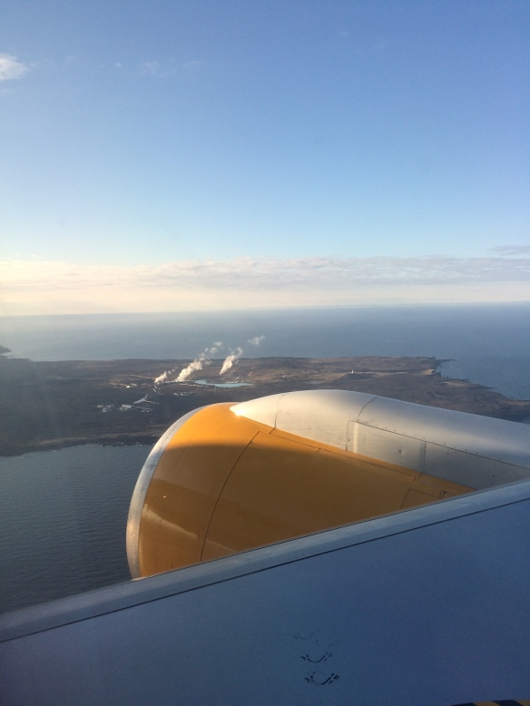 Flying into Iceland - the steam coming up is from one of the many geothermal pools.