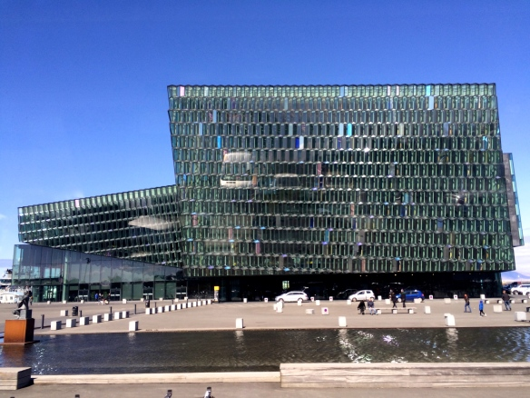 The Harpa concert Hall sits near the harbor, allowing plenty of light to stream through its glass walls.