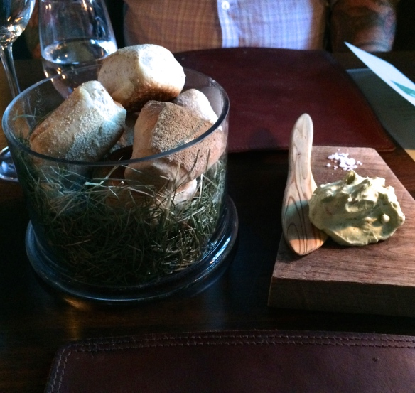 Bread accompanied by whipped lamb fat with herbs