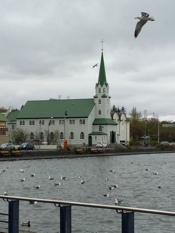 Frikirkjan, the Free Church in Reykjavik, sits beside Tjornin, a picturesque lake close by the city center.