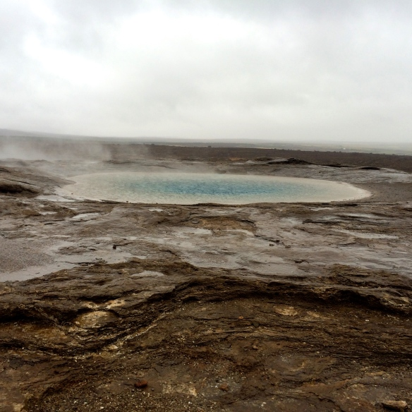 A small geothermal pool by Geysir
