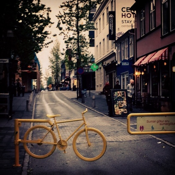 A bike is recycled as part of a fence down one of the main pedestrian streets