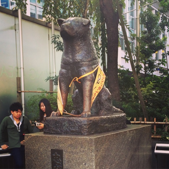 Hachiko sitting proudly outside one of the exits of the Shibuya Station.