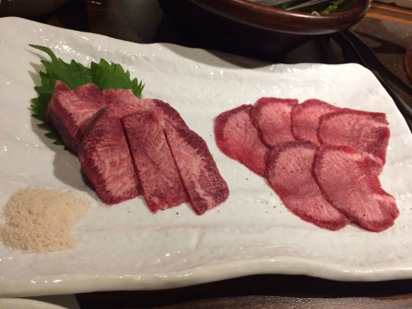 Thinly sliced beef heart and tongue, ready for the grill.